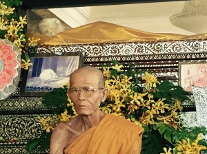 A venerable monk sits in front of the mummified body of a famed, centuries old holy monk (I sought advice before taking this picture to make sure it wouldn't be inappropriate)