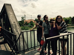 Good looking people on the  bridge